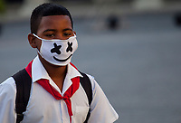 HAVANA, CUBA - March 13:  A cuban child wears a face mask outside of a school in Old Havana, Cuba, Friday, March 13, 2020,  The World Health Organization declared a global pandemic as the coronavirus rapidly spreads across the world.(Photo by Eliana Aponte/VIEWpress)