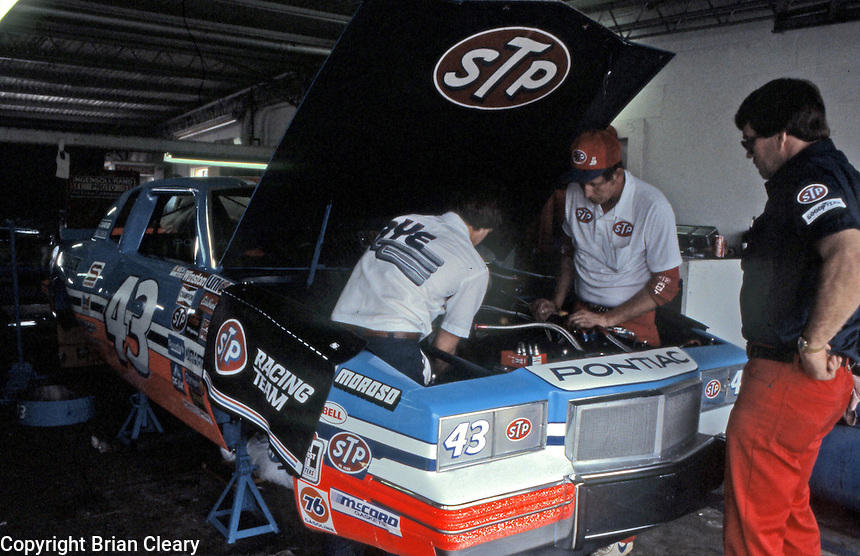 Richard Petty pit crewmen work on car in garage before Daytona 500 at Daytona International Speedway in Daytona Beach, FL on February  1984. (Photo by Brian Cleary/www.bcpix.com)