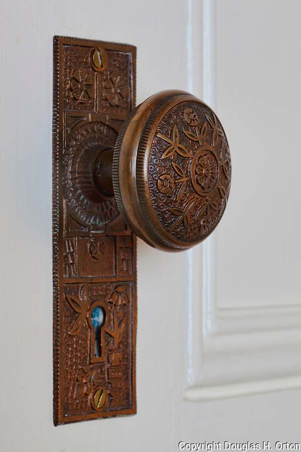 Antique Door Knob in white door.