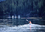 Sea kayaker and orcas in Johnstone Strait