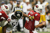 10/23/11 Glendale, AZ: Arizona Cardinals quarterback Kevin Kolb #4 and Pittsburgh Steelers outside linebacker LaMarr Woodley #56 during an NFL game played at University of Phoenix Stadium between the Arizona Cardinals and the Pittsburgh Steelers. The Steelers defeated the Cardinals 32-20.