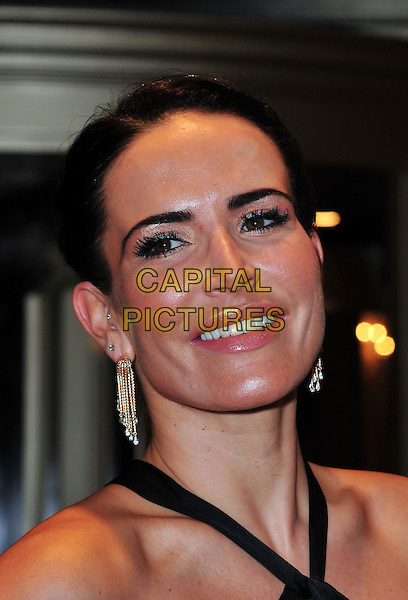 Sophie Anderton.The Amy Winehouse Foundation Ball, Dorchester Hotel, Park Lane, London, England..November 20th, 2012.headshot portrait dangling silver gold earrings black  .CAP/BF.©Bob Fidgeon/Capital Pictures.