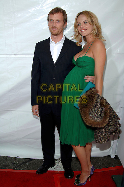 """MONET MAZUR.Los Angeles Premiere of """"Monster-In-Law"""" held at Mann Village Theatre..April 29th, 2005.Photo credit: Jacqui Wong/AdMedia.full length green dress arm around waist pregnant.www.capitalpictures.com.sales@capitalpictures.com.© Capital Pictures."""