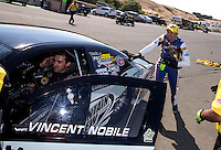 Jul. 28, 2013; Sonoma, CA, USA: NHRA pro stock motorcycle rider Hector Arana Jr helps push the car of pro stock driver Vincent Nobile after winning the Sonoma Nationals at Sonoma Raceway. Mandatory Credit: Mark J. Rebilas-