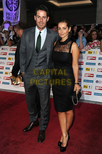 Jamie & Louise Redknapp.'The Daily Mirror's Pride Of Britain Awards 2011' at Grosvenor House Hotel, London, England..3rd October 2011.full length full length black dress hand on hip sleeveless lace clutch bag suit married husband wife .CAP/CAS.©Bob Cass/Capital Pictures.
