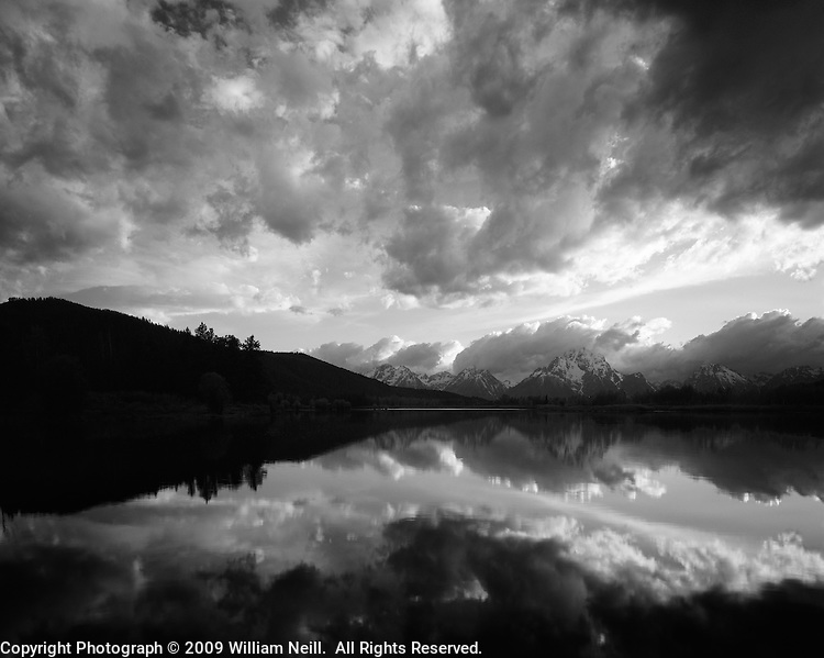 Cloud reflections and Mt Moran at the Oxbow Bend on the Snake River, Grand Teton National Park, Wyoming