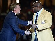 Canton, Ohio - August 6, 2015: Former NFL player Will Shields is congratulated by NFL Commissioner Roger Godell after donning his gold jacket for the first time during the 2015 Pro Football Hall of Fame enshrinement dinner in Canton, Ohio August 6, 2015. During his 14-season career, Shields started every game, never missed a game and earned 12 straight Pro Bowl berths.  (Photo by Don Baxter/Media Images International)
