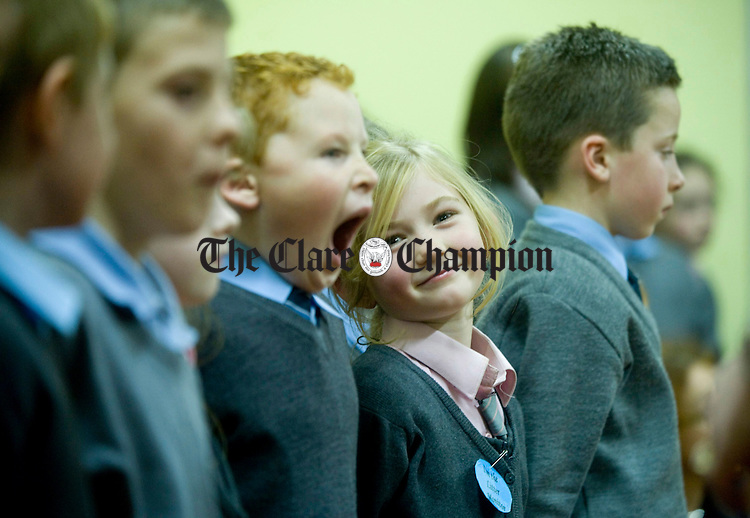 Emma Keating and her classmates waiting for mass to begin during fiftieth anniversary celebrations at Lissycasey National School. Photograph by Declan Monaghan