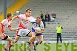 Keels Gary Sayersdrives past St Pat's Eoin Murray during their Junior Championship semi final in Fitzgerald Stadium on Saturday