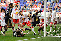 Alejandro Moreno (15) of the Philadelphia Union almost scores while laying on the ground. The New York Red Bulls defeated the Philadelphia Union 2-1 during a Major League Soccer (MLS) match at Red Bull Arena in Harrison, NJ, on April 24, 2010.