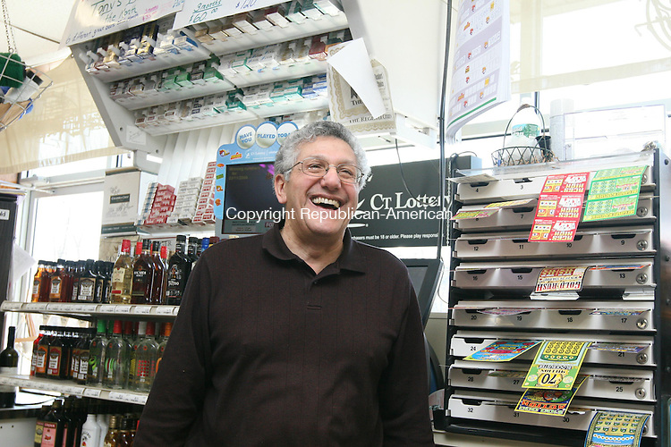 HARWINTON, CT - 13 March, 2009 - 031309MO01 - Michael Nejaime, who has owned Tony's Drive-In Package Store in Harwinton for 40 years and is among the original Connecticut Lottery retailers, said he would be more than happy to tell the state to find another place to sell tickets if commissions are cut. Jim Moore Republican-American.