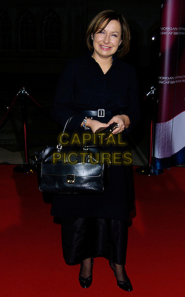 ELSPETH GIBSON.The Morgan Stanley Great Britons Awards 2006 at the Guildhall, London, UK. .January 18th, 2007.full length black coat bag purse dress skirt.CAP/CAN.©Can Nguyen/Capital Pictures