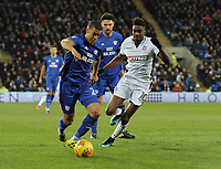 Cardiff City's Lee Peltier under pressure from Bolton Wanderers' Sammy Ameobi<br /> <br /> Photographer Kevin Barnes/CameraSport<br /> <br /> The EFL Sky Bet Championship - Cardiff City v Bolton Wanderers - Tuesday 13th February 2018 - Cardiff City Stadium - Cardiff<br /> <br /> World Copyright &copy; 2018 CameraSport. All rights reserved. 43 Linden Ave. Countesthorpe. Leicester. England. LE8 5PG - Tel: +44 (0) 116 277 4147 - admin@camerasport.com - www.camerasport.com