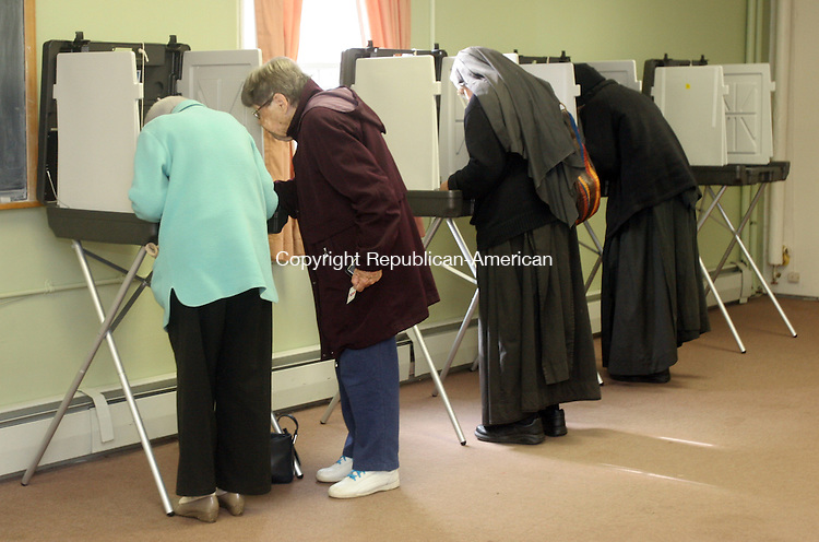 BETHLEHEM, CT-05 November 2013-110513TK12-  Voters along with sisters from the Abbey of Regina Laudis vote Tuesday at Bethlehem Town Hall Tuesday. Tom Kabelka Republican-American