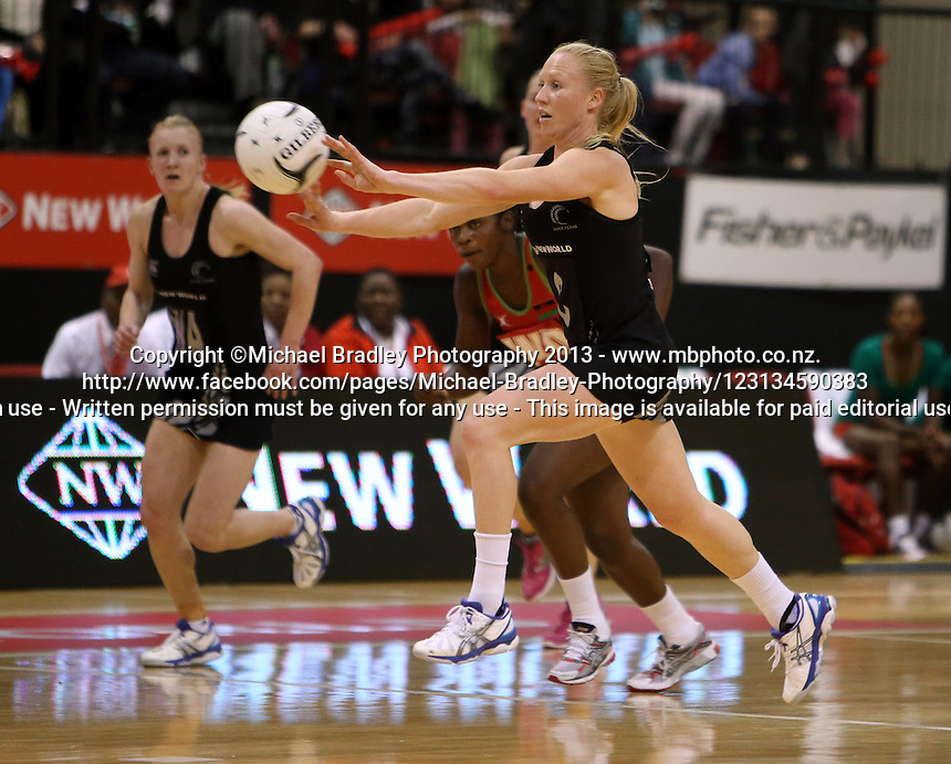 24.10.2013 Silver Fern Laura Langman in action during the Silver Ferns V Malawi New World Netball Series played at the TSB Bank Arena in Wellington. Mandatory Photo Credit ©Michael Bradley.