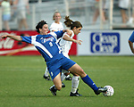 Birgit Prinz (left) and Mia Hamm (right) fight for the ball at SAS Stadium in Cary, North Carolina on 6/11/03 during a game between the Carolina Courage and Washington Freedom. Carolina won the game 3-0.