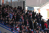 Kingstonian fans display an Amar Out sign during Macclesfield Town vs Kingstonian, Emirates FA Cup Football at the Moss Rose Stadium on 10th November 2019