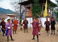 Archers in a contest with high-technology bows and arrows.  Archery is Bhutan's national sport.