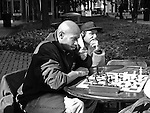 Men play chess at the corner of Trade St. and Tryon St. Charlotte,NC 3 Feb 2010<br /> Scott LePage/SSA