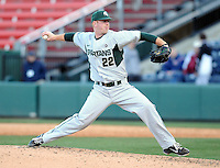 Pitcher Bryce Jenney (22) of the Michigan State Spartans in a game against the Furman Paladins on February 25, 2012, at Fluor Field in Greenville, South Carolina. (Tom Priddy/Four Seam Images)
