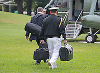 A United States Marine walks to Marine One with a briefcase holding nuclear launch codes to accompany US President Barack Obama as he departs the South Lawn of the White House in Washington, DC on Thursday, October 13, 2016 en route to Joint Base Andrews in Maryland for a trip to Pennsylvania and Ohio.<br /> Credit: Ron Sachs / CNP /MediaPunch