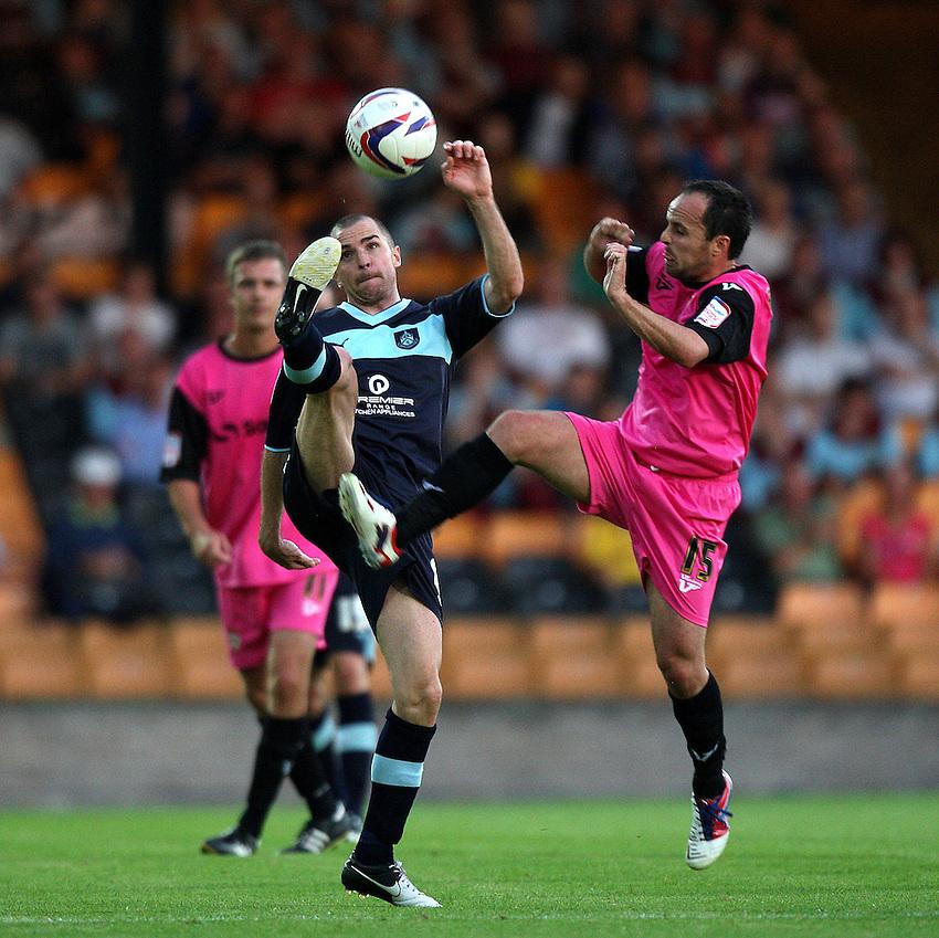 Burnley's Dean Marney battles with Port Vale's Chris Shuker ..Football - Football - Capital One Cup First Round - Port Vale v Burnley - Tuesday 14th August 2012 - Vale Park - Burslem. .