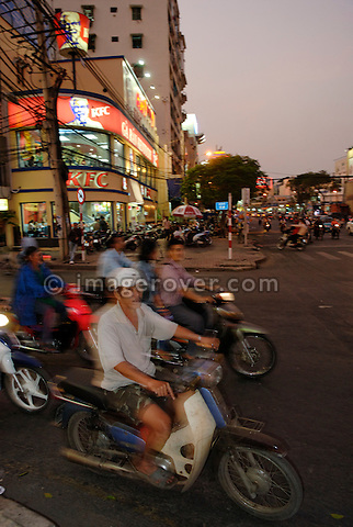 Asia, Vietnam, Ho Chi Minh City (Saigon). Typical motorbike traffic.