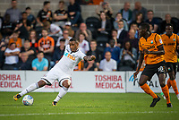 Luciano Narsingh of Swansea City takes a shot at goal under pressure from Wesley Fonguck of Barnet during the 2017/18 Pre Season Friendly match between Barnet and Swansea City at The Hive, London, England on 12 July 2017. Photo by Andy Rowland.