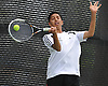 Nikhil Rajesh of Syosset returns a volley during the Nassau County varsity boys' tennis doubles consolation final against Alan Delman and Simon Kashfi of Great Neck North at Oceanside High School on Satuday, May 16, 2015.<br /> <br /> James Escher