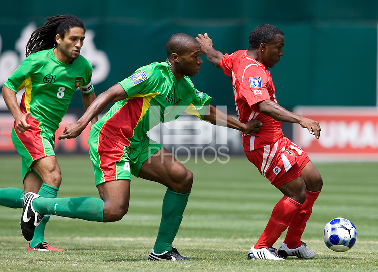 05 July 2009:  Ricardo Phillips of Panama kicks the ball away from Cedric Avinel of Guadeloupe during the game at Oakland-Alameda County Coliseum in Oakland, California.   Guadeloupe defeated Panama, 2-0.