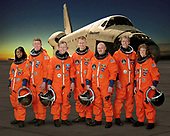 FILE: In this photo released by NASA, these seven astronauts take a break from training to pose for the STS-121 crew portrait in Houston, Texas on April 5, 2006. From the left are astronauts Stephanie D. Wilson, Michael E. Fossum, both mission specialists; Steven W. Lindsey, commander; Piers J. Sellers, mission specialist; Mark E. Kelly, pilot; European Space Agency (ESA) astronaut Thomas Reiter of Germany; and Lisa M. Nowak, both mission specialists. The crew members are attired in training versions of their shuttle launch and entry suit.<br /> Credit: NASA via CNP
