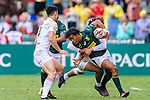 Stedman Gans of South Africa (C) is tackled by Ryan Olowofela of England (H) during the HSBC Hong Kong Sevens 2018 match between South Africa and England on April 7, 2018 in Hong Kong, Hong Kong. Photo by Marcio Rodrigo Machado / Power Sport Images