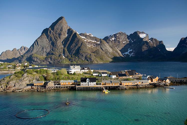 Fisherman cabins at Sakrisoya surrounded by Reinefjord, Mosekenesoya, Lofoten Islands, Norway
