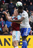 Burnley's Ashley Barnes vies for possession with Cardiff City's Bruno Ecuele Manga<br /> <br /> Photographer Rich Linley/CameraSport<br /> <br /> The Premier League - Saturday 13th April 2019 - Burnley v Cardiff City - Turf Moor - Burnley<br /> <br /> World Copyright &copy; 2019 CameraSport. All rights reserved. 43 Linden Ave. Countesthorpe. Leicester. England. LE8 5PG - Tel: +44 (0) 116 277 4147 - admin@camerasport.com - www.camerasport.com