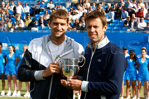 17.06.12 Queens Club, London, ENGLAND: .MIRNYI, Max (BLR)/NESTOR, Daniel (CAN) with Trophy.mens doubles final round match during MIRNYI, Max (BLR)/NESTOR, Daniel (CAN) versus BRYAN, Bob (USA)/BRYAN, Mike (USA) on day Seven of the Aegon Championships at Queens Club .on June 17, 2012 in London , England.....