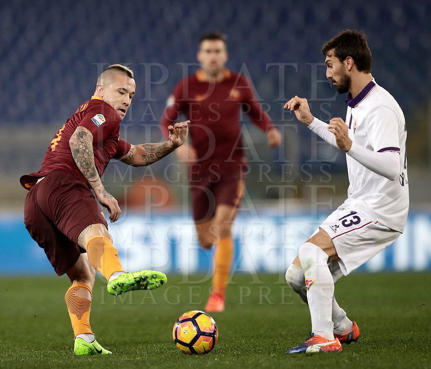 Calcio, Serie A: Roma, Stadio Olimpico, 7 febbraio 2017.<br /> Roma's Radja Nainggolan (l) in action with Fiorentina's Davide Astori (l) during the Italian Serie A football match between AS Roma and Fiorentina at Roma's Olympic Stadium, on February 7, 2017.<br /> UPDATE IMAGES PRESS/Isabella Bonotto