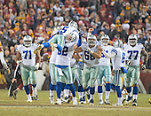 Dallas Cowboys kicker Dan Bailey (5) is carried by tight end Jason Witten (82) after kicking the game-winning field goal with nine seconds left in the game against the Washington Redskins at FedEx Field in Landover, Maryland on Monday, December 7, 2015.  Also pictured are Cowboys offensive guard La'el Collins (71), tackle Doug Free (68), punter Chris Jones (6) and tackle Tyron Smith (77).  The Cowboys won the game 19-16.<br /> Credit: Ron Sachs / CNP