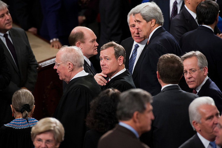 UNITED STATES - JANUARY 20: Chief Justice of the Supreme Court  John Roberts greets guests in the Capitol's House chamber before President Barack Obama's State of the Union address, January 20, 2015. (Photo By Tom Williams/CQ Roll Call)