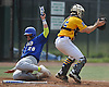 James Kory #26 of West Islip, left, slides home safely in the top of the first inning in the Class AA varsity baseball Long Island Championship against East Meadow at Farmingdale State College on Saturday, June 4, 2016.