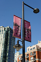 Banners on a lamp post in Yaletown, Vancouver, British Columbia, Canada