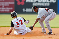 Jonathan Schoop #46 of the Delmarva Shorebirds tags out Mike Blanke #32 of the Kannapolis Intimidators as he tries to steal second base at Fieldcrest Cannon Stadium on May 22, 2011 in Kannapolis, North Carolina.   Photo by Brian Westerholt / Four Seam Images