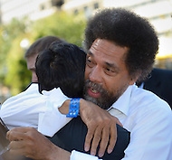 October 17, 2011  (Washington, DC)  Dr. Cornel West hugs Keane Bhatt after their appearance before a judge at the DC Superior Court.  West, Bhatt and 15 others, including participants in Occupy DC and members of October2011, were arrested for protesting on the grounds of the US Supreme Court on October 16, 2011, the day of the MLK Memorial Dedication.    (Photo by Don Baxter/Media Images International)