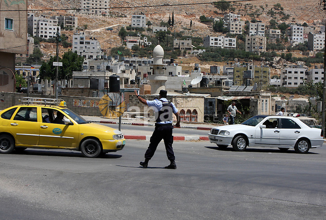 Palestinian policeman regulates movement of traffic in the West Bank city of Nablus on June 30,2010. Russia granted the Palestinian Authority 50 armored personnel carriers on June 29.. Photo by Wagdi Eshtayah