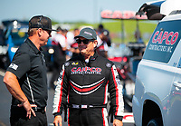 Jun 8, 2019; Topeka, KS, USA; NHRA top fuel driver Billy Torrence (right) talks with Mike Neff during qualifying for the Heartland Nationals at Heartland Motorsports Park. Mandatory Credit: Mark J. Rebilas-USA TODAY Sports
