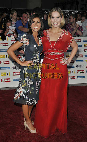 Lucy Verasamy & Kirsty McCabe.'The Daily Mirror's Pride Of Britain Awards 2011' at Grosvenor House Hotel, London, England..3rd October 2011.full length black pink floral print red sheer dress hand on hip.CAP/CAN.©Can Nguyen/Capital Pictures.