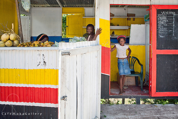 Ras Bones Heartical Foods,fruit and vegetable vendors stall painted i red, yellow and black, Buccament Bay, children helping