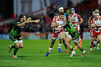 Jonny May of Gloucester Rugby is tackled late by Jack Nowell of Exeter Chiefs after chipping ahead during the European Rugby Challenge Cup semi final match between Gloucester Rugby and Exeter Chiefs at Kingsholm Stadium on Saturday 18th April 2015 (Photo by Rob Munro)