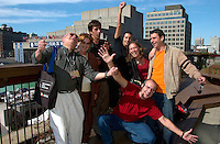 Spanish director  Juanjo GimÈnez Pena<br />  (red shirt) pose for an exclusive photo in front of the Maisonneuve Theater after the press conference for his first movie `TILT (Nos Hacemos Falta) presented in the official  competition at the 25thWorld Film Festival in Montreal , Canada, September 2nd 2001.<br /> <br /> From left to right :<br /> ProducerLuis Angel Bellaba and hid wifeSusana Rizuti<br /> Co-scriptwriter Miguel AngelBaixauli<br /> Actor Pepe Pereza<br /> the Producer's daughter Andrea Bellaba<br /> Oscar Diez<br /> and (kneeling) with arms extended) director  Juanjo GimÈnez Pena<br /> <br /> <br /> <br /> <br /> <br /> Photo by Pierre Roussel / Getty Images News Service (ON SPEC)<br /> <br /> <br /> <br /> NOTE : Nikon D-1 JPEG opened with QUIMAGE ICC profile , saved as Adobe RG 1998 color space.