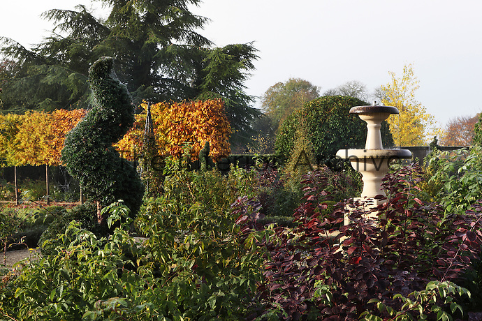The flowerbeds are full of rich autumnal shades of red, yellow, orange and purple