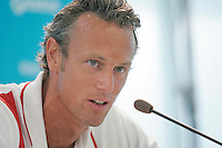 13 MAR 2006 - MELBOURNE, AUSTRALIA - Mark Foster (ENG) answers questions at the English Swimming team press conference at the 2006 Commonwealth Games. (PHOTO (C) NIGEL FARROW)